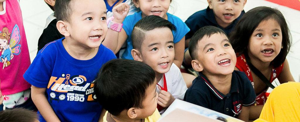 Children listening to their teacher's story.